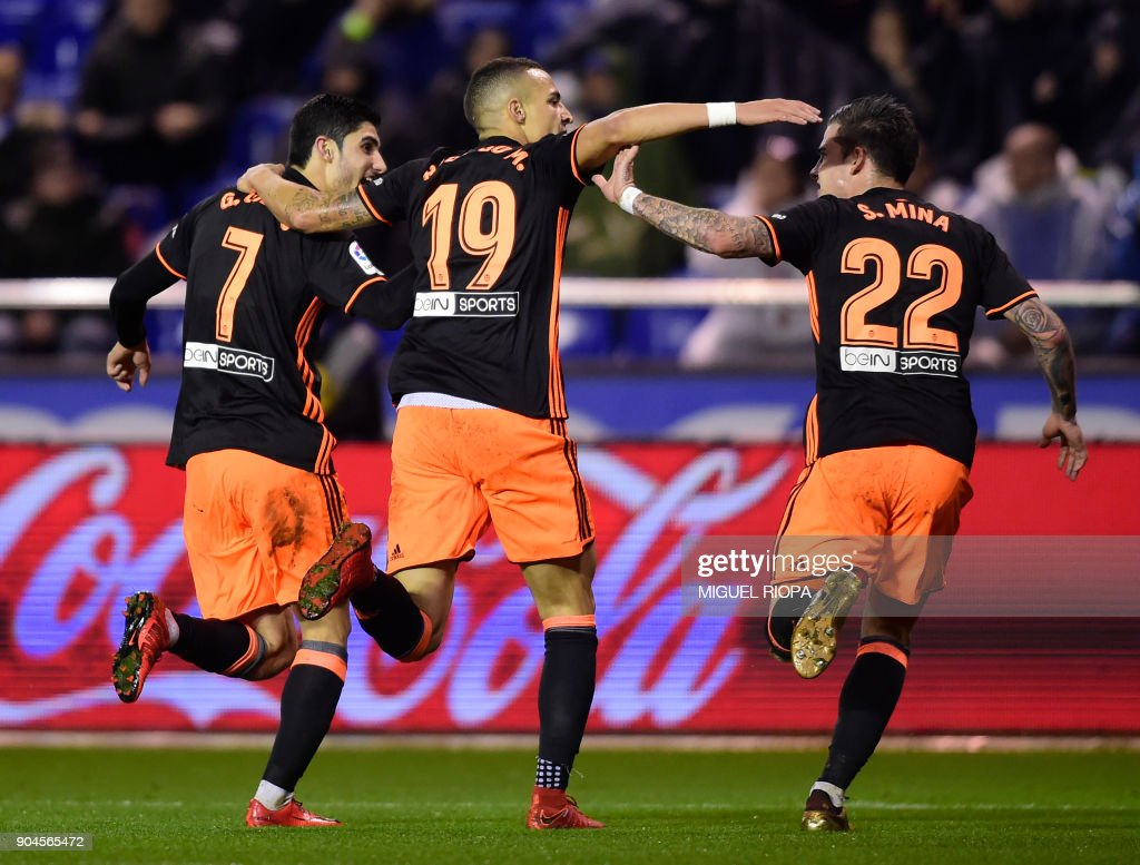 Valencia's Portuguese forward Goncalo Guedes (L) celebrates a goal with Valencia's Spanish forward Rodrigo Moreno (C) and Valencia's Spanish forward Santiago Mina Lorenzo during the Spanish league football match between RC Deportivo de la Coruna and Valencia CF at the Municipal de Riazor stadium in La Coruna on January 13, 2018. /