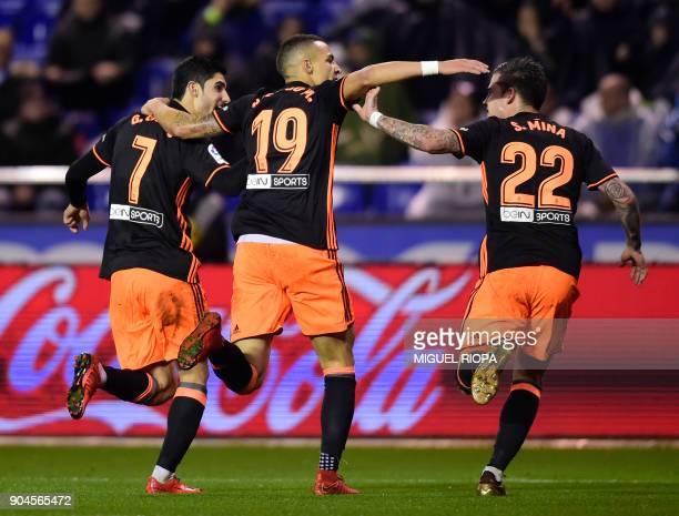 Valencia's Portuguese forward Goncalo Guedes celebrates a goal with Valencia's Spanish forward Rodrigo Moreno and Valencia's Spanish forward Santiago...