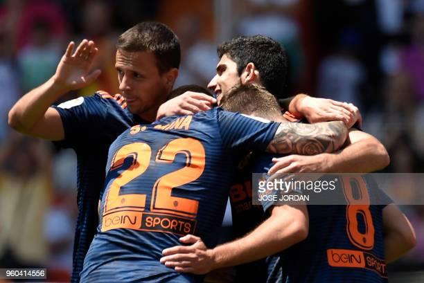 Valencia's Portuguese forward Goncalo Guedes celebrates a goal with Valencia's Serbian midfielder Nemanja Maksimovic during the Spanish league...