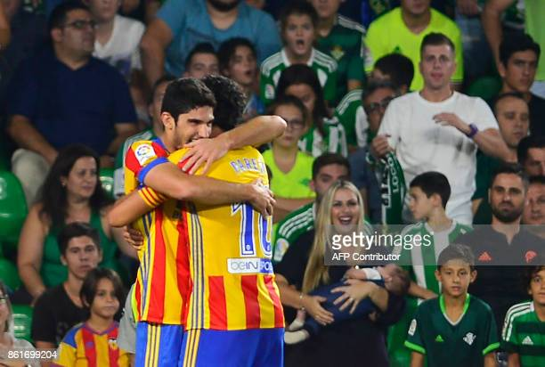 Valencia's Portuguese forward Goncalo Guedes celebrates after scoring a goal during the Spanish league football match Real Betis FC vs Valencia FC at...