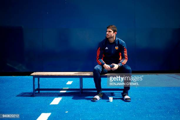 Valencia's Portuguese forward Goncalo Guedes sits on a bench ahead of the Spanish League football match between Leganes and Valencia at the Butarque...