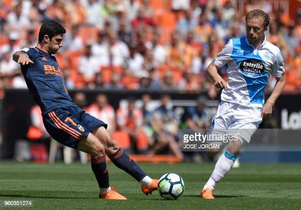 Valencia's Portuguese forward Goncalo Guedes vies with Deportivo La Coruna's Danish midfielder Michael KrohnDehli during the Spanish league football...