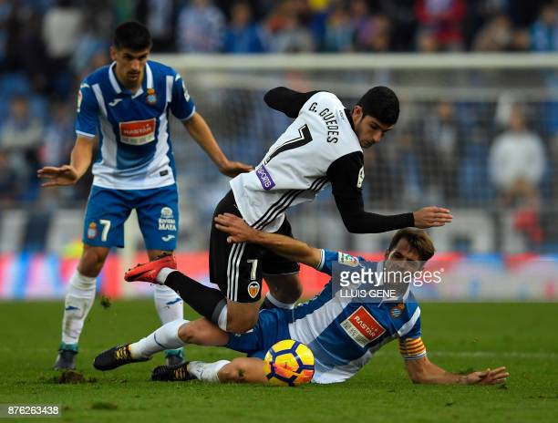 Valencia's Portuguese forward Goncalo Guedes vies with Espanyol's Spanish midfielder Victor Sanchez during the Spanish league football match RCD...