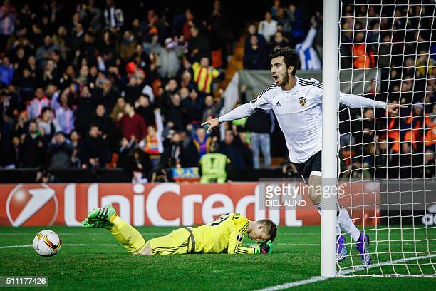 Valencia's Portuguese midfielder Andre Gomes celebrates a goal during the UEFA Europa League Round of 32 first leg football match Valencia CF vs SK...