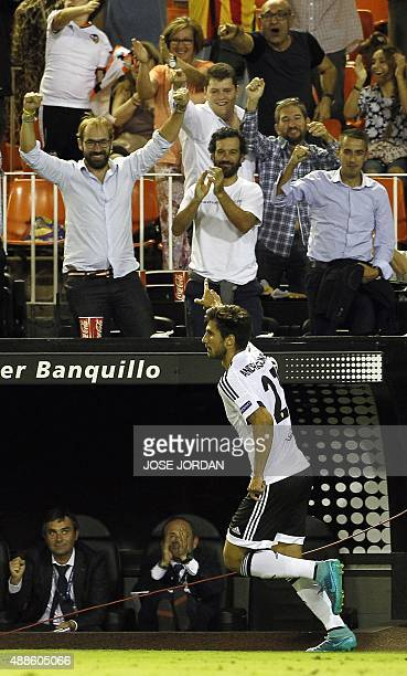 Valencia's Portuguese midfielder Andre Gomes celebrates his goal during the UEFA Champions League group H football match Valencia CF vs FC Zenit at...