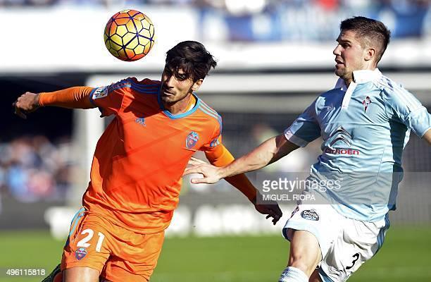 Valencia's Portuguese midfielder Andre Gomes vies with Celta Vigo's defender Andreu Fontas during the Spanish league football match RC Celta de Vigo...