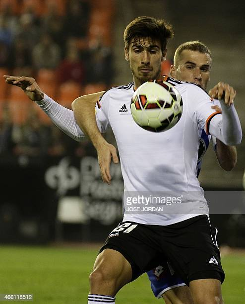 Valencia's Portuguese midfielder Andre Gomes vies with Deportivo's midfielder Alex during the Spanish league football match Valencia CF vs RC...