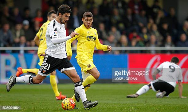 Valencia's Portuguese midfielder Andre Gomes vies with Villarreal's Mexican forward Jonathan dos Santos during the Spanish league football match...