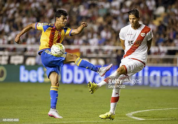 Valencia's Portuguese midfielder Danilo Barbosa kicks the ball past Rayo's Portuguese defender Ze Castro during the Spanish league football match...