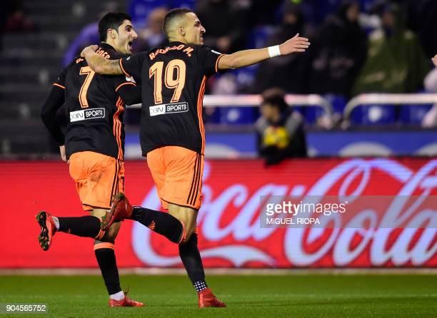 Valencia's Portuguese midfielder Goncalo Guedes celebrates a goal with teammate Valencia's Spanish forward Rodrigo Moreno during the Spanish league...