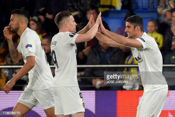 Valencia's Portuguese midfielder Goncalo Guedes celebrates scoring the opening goal with Valencia's French forward Kevin Gameiro during the UEFA...