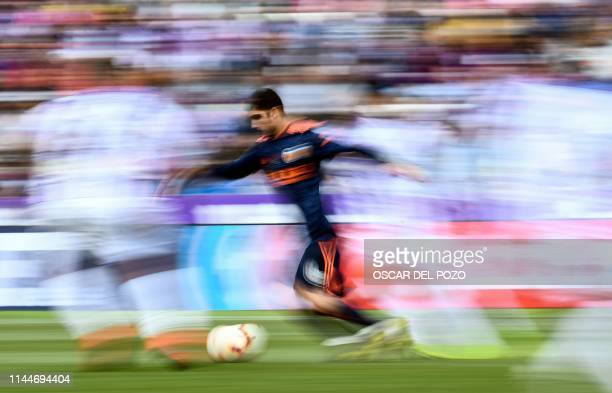 Valencia's Portuguese midfielder Goncalo Guedes runs with the ball during the Spanish League football match between Real Valladolid and Valencia at...
