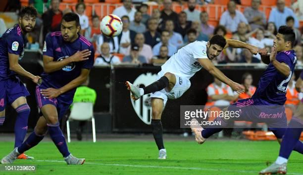 Valencia's Portuguese midfielder Goncalo Guedes shoots during the Spanish league football match Valencia CF against RC Celta de Vigo at the Mestalla...