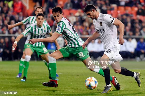 Valencia's Portuguese midfielder Goncalo Guedes vies with Real Betis' Algerian defender Aissa Mandi during the Spanish Copa del Rey semifinal second...