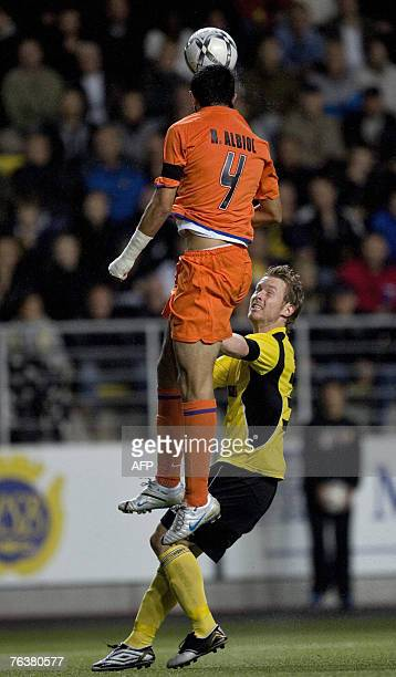 Valencia's Raul Albiol vies for the ball with IT Elfsborgs Fredrik Berglund during their Champions League football qualifying match 29 August 2007 in...