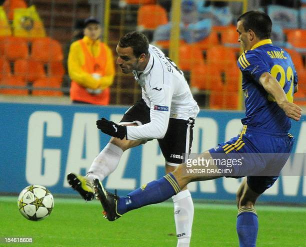 Valencia's Roberto Soldado vies with BATE Borisov's Marko Simic during their Champions League Group F football match in Minsk on October 23 2012 AFP...