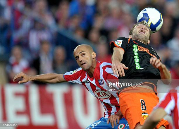 Valencia's Ruben Baraja fights for the ball with Atletico Madrid's Pernia during their Spanish league football match at Vicente Calderon Stadium in...