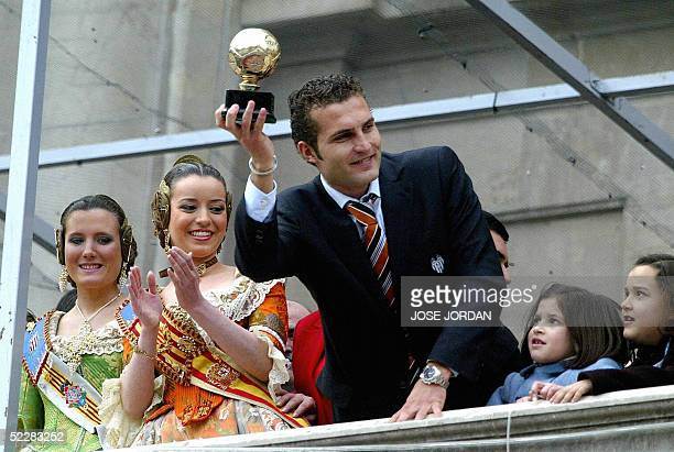 Valencia's Ruben Baraja shows the trophy of the 2004 world's best team at the city hall balcony during the Mascleta of the Fallas festival in...