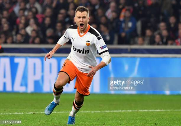 Valencia's Russian midfielder Denis Cheryshev celebrates after scoring a goal during the UEFA Champions League Group H football match between Lille...