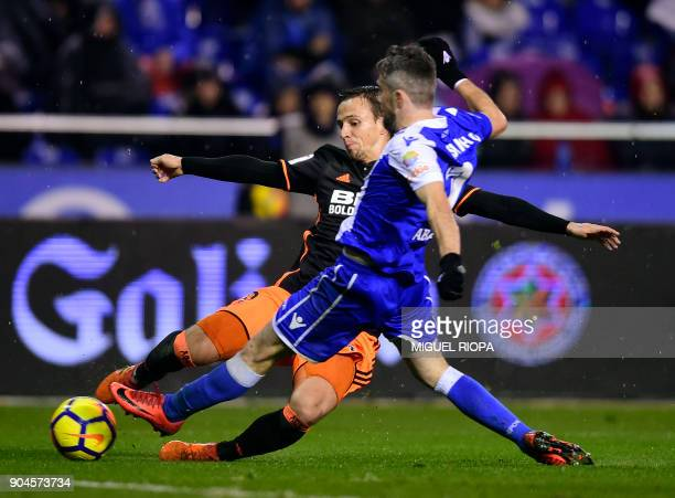 Valencia's Serbian midfielder Nemanja Maksimovic vies with Deportivo La Coruna's Portuguese defender Luisinho during the Spanish league football...