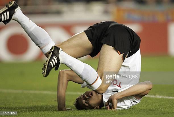 Valencia's Serbian Nikola Zigic rolls over the pitch during a Champions League Group B football match against Rosenborg at the Mestalla stadium in...
