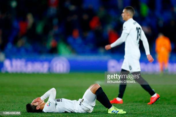Valencia's South Korean forward Lee Kangin gestures at the end of the Spanish Copa del Rey quarterfinal first leg football match between Getafe and...
