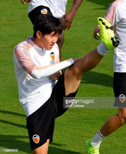 Valencia's South Korean midfielder Lee KangIn takes part in a training session at the Paterna Sports City in Paterna on September 16 2019 on the eve...