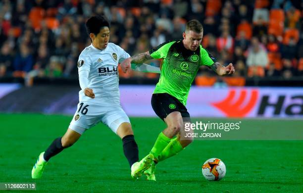 Valencia's South Korean midfielder Lee Kangin vies for the ball with Celtic's Irish striker Jonny Hayes during the UEFA Europa League round of 32...