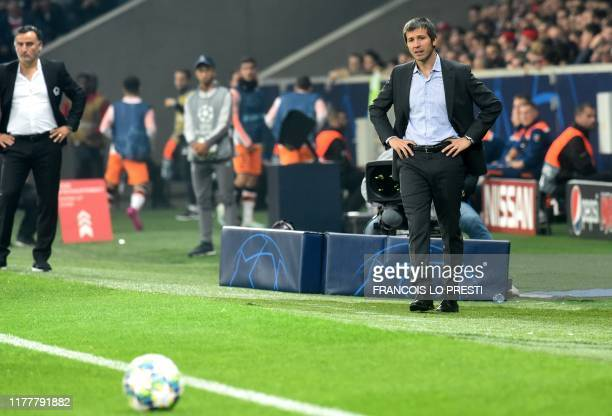 Valencia's Spanish coach Albert Celades and Lille's French coach Christophe Galtier follow the UEFA Champions League Group H football match between...