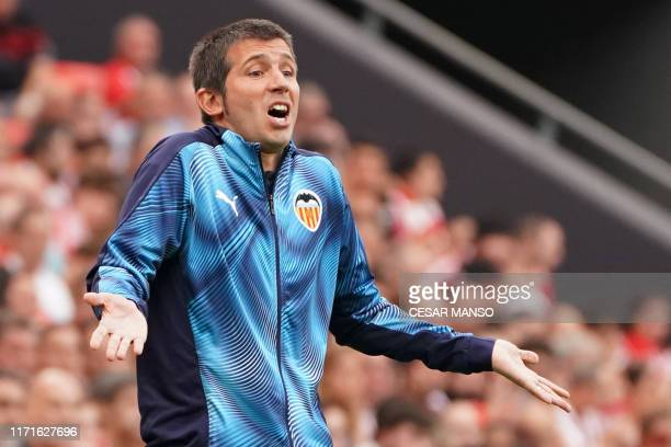 Valencia's Spanish coach Albert Celades gestures during the Spanish league football match between Athletic Club Bilbao and Valencia CF at the San...