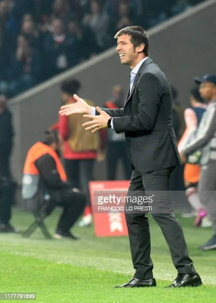 Valencia's Spanish coach Albert Celades reacts during the UEFA Champions League Group H football match between Lille OSC and Valencia CF at the Stade...