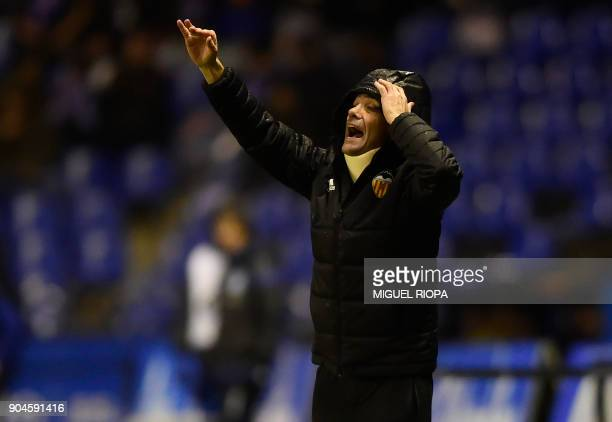 Valencia's Spanish coach Marcelino Garcia Toral gives instructions from the sideline during the Spanish league football match between RC Deportivo de...