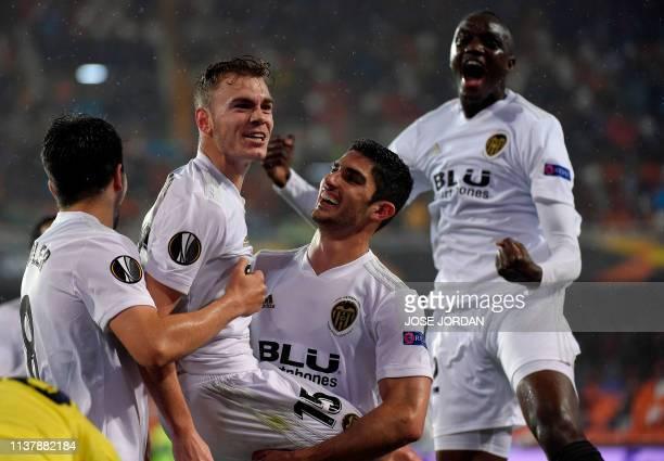 Valencia's Spanish defender Antonio Latorre Lato celebrates scoring the opening goal with teammates during the UEFA Europa League quarter final...