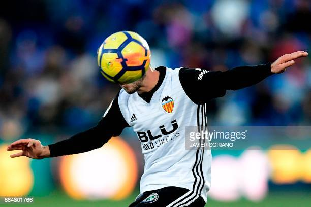 TOPSHOT Valencia's Spanish defender Jose Luis Gaya Pena controls the ball during the Spanish league football match Getafe CF vs Valencia CF at the...