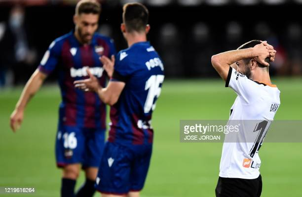 Valencia's Spanish defender Jose Luis Gaya Pena gestures during the Spanish League football match between Valencia and Levante at the Mestalla...