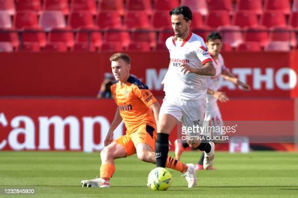 Valencia's Spanish defender Toni Lato vies with Sevilla's Spanish midfielder Suso during the Spanish league football match Sevilla FC against...
