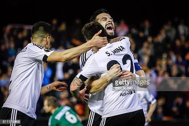Valencia's Spanish forward Alvaro Negredo celebrates a goal during the UEFA Europa League Round of 32 first leg football match Valencia CF vs SK...