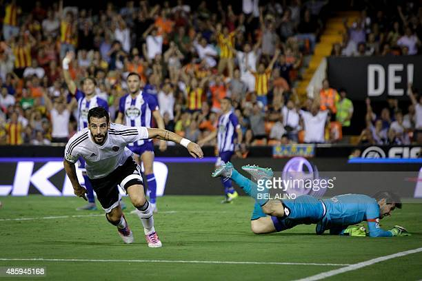 Valencia's Spanish forward Alvaro Negredo celebrates after scoring during the Spanish league football match Valencia CF vs RC Deportivo de La Coruna...