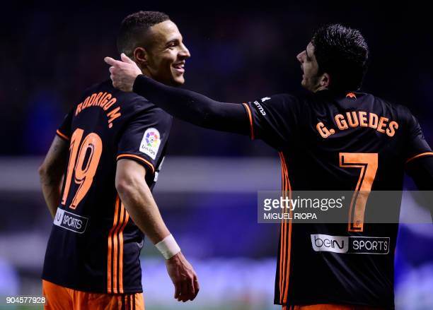 Valencia's Spanish forward Rodrigo Moreno celebrates a goal with teammate Portuguese midfielder Goncalo Guedes during the Spanish league football...