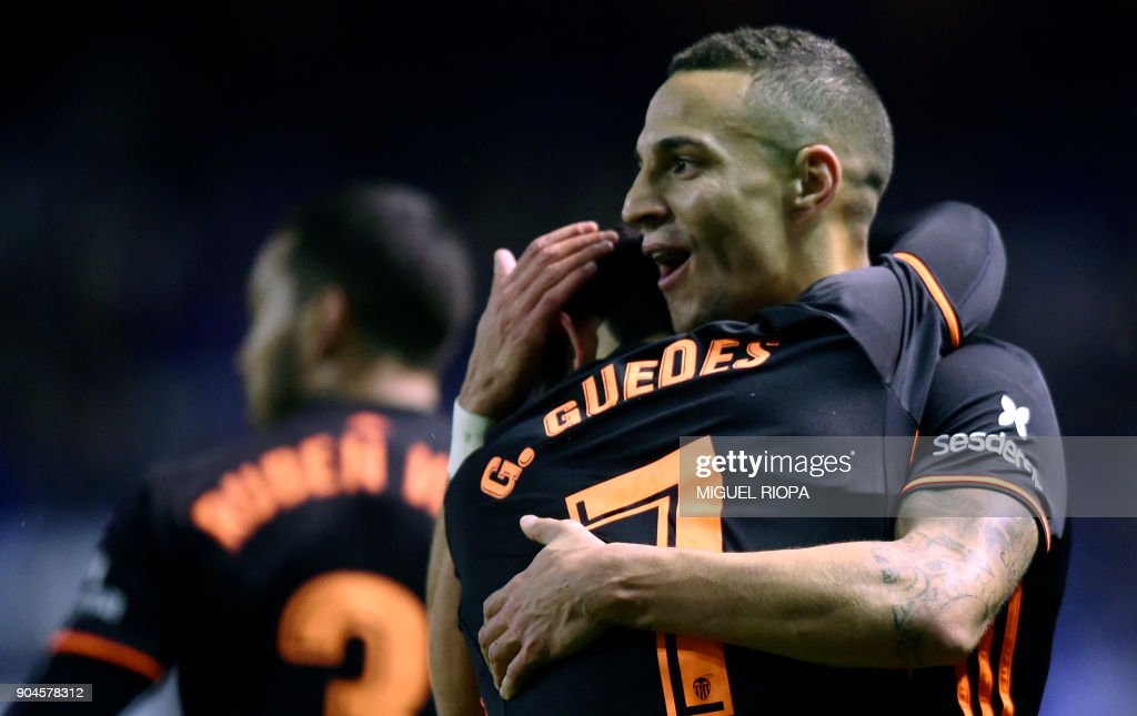 Valencia's Spanish forward Rodrigo Moreno (R) celebrates a goal with teammate Portuguese midfielder Goncalo Guedes during the Spanish league football match between RC Deportivo de la Coruna and Valencia CF at the Municipal de Riazor stadium in La Coruna on January 13, 2018. /