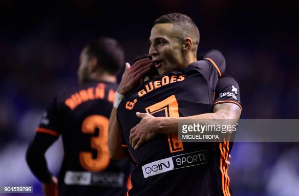 Valencia's Spanish forward Rodrigo Moreno celebrates a goal with Portuguese midfielder Goncalo Guedes during the Spanish league football match...