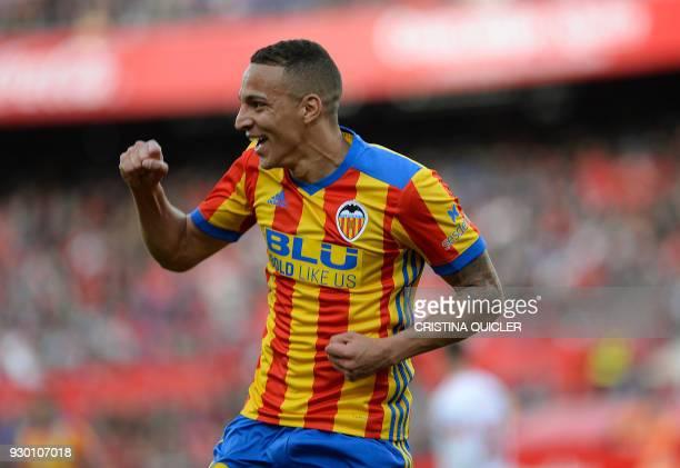 Valencia's Spanish forward Rodrigo Moreno celebrates after scoring a goal during the Spanish league football match between Sevilla and Valencia at...