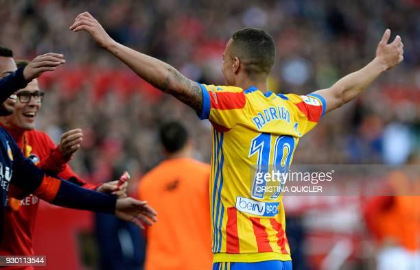 Valencia's Spanish forward Rodrigo Moreno celebrates after scoring a goal during the Spanish league football match between Sevilla FC and Valencia CF...