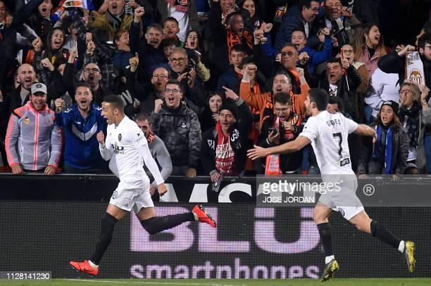 Valencia's Spanish forward Rodrigo Moreno celebrates his goal during the Spanish Copa del Rey semifinal second leg football match between Valencia CF...