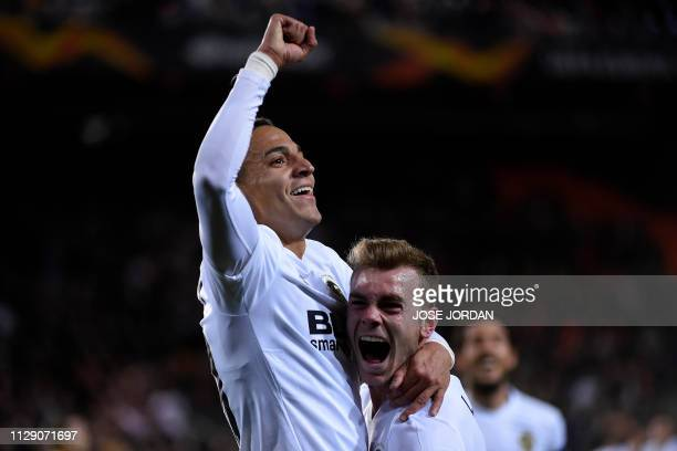 Valencia's Spanish forward Rodrigo Moreno celebrates with Valencia's Spanish defender Antonio Latorre after scoring a goal during the Europa League...