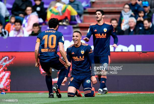 Valencia's Spanish forward Rodrigo Moreno celebrates with Valencia's Spanish midfielder Daniel Parejo after scoring a goal during the Spanish League...