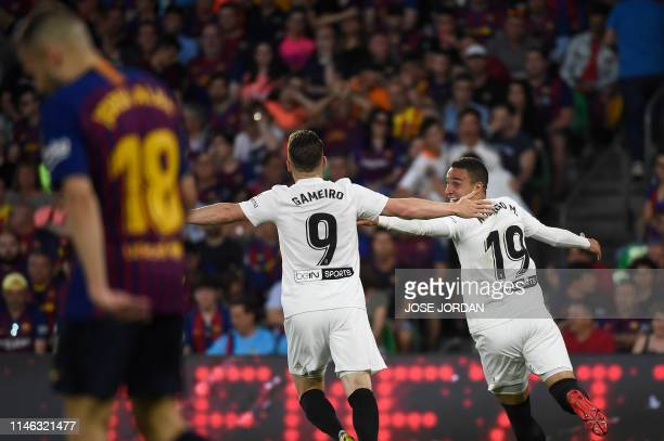 TOPSHOT Valencia's Spanish forward Rodrigo Moreno celebrates with Valencia's French forward Kevin Gameiro after scoring his team's second goal during...