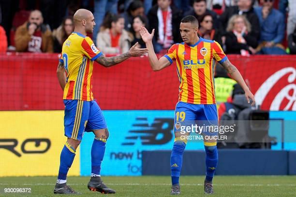 Valencia's Spanish forward Rodrigo Moreno celebrates with Valencia's Italian forward Simone Zaza after scoring a goal during the Spanish league...
