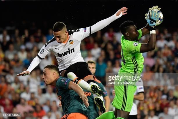Valencia's Spanish forward Rodrigo Moreno challenges Ajax's US defender Sergino Dest and Ajax's Cameroon goalkeeper Andre Onana during the UEFA...