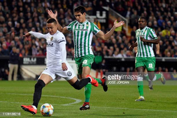 Valencia's Spanish forward Rodrigo Moreno vies with Real Betis' Algerian defender Aissa Mandi during the Spanish Copa del Rey semifinal second leg...